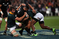 Lood de Jager and Raymond Rhule tackling Lima Sopoaga during the Rugby Championship match between the New Zealand All Blacks and South Africa Springboks at QBE Stadium in Albany, Auckland, New Zealand on Saturday, 16 September 2017. Photo: Shane Wenzlick / lintottphoto.co.nz