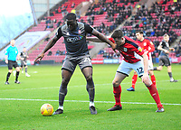 Lincoln City's John Akinde shields the ball from Crewe Alexandra's Eddie Nolan<br /> <br /> Photographer Andrew Vaughan/CameraSport<br /> <br /> The EFL Sky Bet League Two - Crewe Alexandra v Lincoln City - Wednesday 26th December 2018 - Alexandra Stadium - Crewe<br /> <br /> World Copyright &copy; 2018 CameraSport. All rights reserved. 43 Linden Ave. Countesthorpe. Leicester. England. LE8 5PG - Tel: +44 (0) 116 277 4147 - admin@camerasport.com - www.camerasport.com