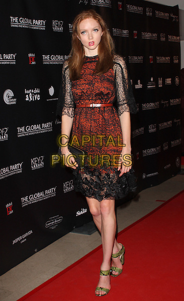 LILY COLE.The Global Party - Arrivals, Natural History Museum, London, England..September 8th, 2011.full length red orange lace dress clutch bag green ankle strap shoes black.CAP/ROS.©Steve Ross/Capital Pictures