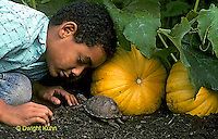 1R14-014z Minority Child with Box Turtle in Garden.