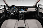 Stock photo of straight dashboard view of 2016 Toyota Corolla LE Plus 4 Door Sedan Dashboard