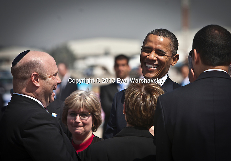 U.S. President Barack Obama shares a light moment during his arrival ceremony at Ben Gurion International Airport near Tel Aviv Wednesday March 20, 2013. U.S. President Barack Obama arrived in Israel early Wednesday afternoon and was greeted by Prime Minister Benjamin Netanyahu, President Shimon Peres, and all of the ministers of Israel's recently formed government. Photo by Eyal Warshavsky.