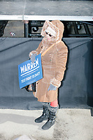 A woman holds a Warren campaign sign after Elizabeth Warren announced her candidacy for the 2020 presidential election at Everett Mills, site of the 1912 Bread and Roses strike, in Lawrence, Massachusetts, USA, on Sat., Feb. 9, 2019.