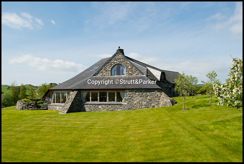 BNPS.co.uk (01202 558833)<br /> Pic: Strutt&Parker/BNPS<br /> <br /> ***Please use full byline***<br /> <br /> A stunning country pad that looks like it could have been designed by Hobbit hero Bilbo Baggins has gone on the market for one million pounds.<br /> <br /> The wonderfully wacky house appears to blend in with its surroundings, just like the Lord of the Rings character's humble Hobbit hole.<br /> <br /> The plush five-bedroom property is nestled deep in the rolling hills of Wales' Snowdonia National Park - although it would not look out of place in Middle Earth.<br /> <br /> The house is called Cynefin, meaning 'a sense of place' in Welsh, and is in the tiny village of Llanegryn in Gwynedd wih unrivalled views over the Dysynni Valley.<br /> <br /> It is on the market through estate agents Strutt and Parker for £985,000.
