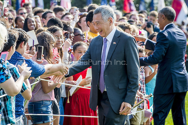 Prime Minister Lee Hsien Loong of Singapore greets guests during official welcoming ceremonies on the South Lawn of the White House in Washington, DC on August 2, 2016. Lee is on a State Visit to the United States.   <br /> Credit: Pete Marovich / Pool via CNP/MediaPunch