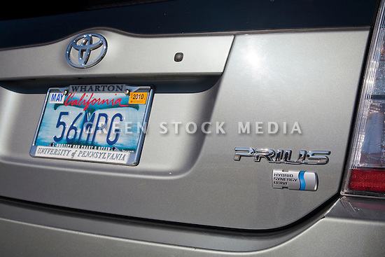 Close up of Kendrick Li's 2004 Toyota Prius which has a '56 MPG' (56 miles per gallon) custom license plate. People pay for the customized plates and the proceeds support various causes. The fees collected for these Whale Tail License Plates support the California Coastal Commission environmental projects. Li was inspired to get the plate because the Prius was rated at 40 to 60 miles per gallon fuel economy. By the time he purchased the plate all of the other numbers between 40 and 60 had been taken. He admits his Prius does get less than 56 MPG but it's still very fuel efficient and the new models are even better. California, USA
