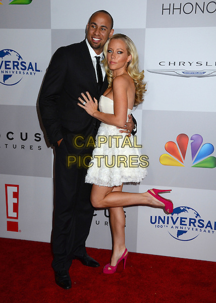 Hank Baskett & Kendra Wilkinson .NBC Universal Golden Globes After Party held at the Beverly Hilton Hotel, Hollywood, California, USA..January 15th, 2012.full length black suit white strapless dress leg foot up red shoes married husband wife .CAP/ADM/BT.©Birdie Thompson/AdMedia/Capital Pictures.