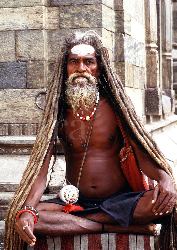 An elderly Hindi man, dying of malaria and hepatitis at the House of Death. His long hair and medatative demeanor indicate that he is a traditional religious practitioner of Ascetics. Kathmandu, Nepal.