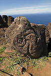 Chile, Easter Island: Orongo Village, restored archeological site where the birdman cult was practiced.  The birdman cult decided king-of-year governance by requiring athletes to bring the first egg of the season from offshore islands.  The athlete's patron became king.  The site has stone houses, petroglyphs, and a crater lake where the athletes cut reeds to make rafts to get to the island..Photo #: ch279-33731..Photo copyright Lee Foster www.fostertravel.com lee@fostertravel.com 510-549-2202