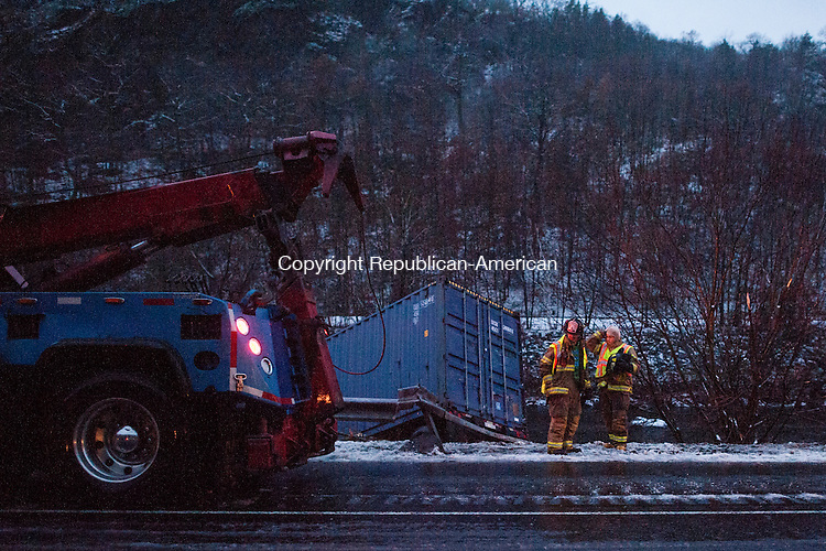 BEACON FALLS, CT-26 November 2014-112614EC06-  Emergency crews tend to a tractor trailer which overturned and slide down the embankment of the Naugatuck River Wednesday. It happened during the afternoon commute along Route 8 south, between exits 24 and 35 in Beacon Falls. Erin Covey Republican-American