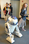Garden City, New York, U.S. - June 14, 2014 - R2-D2, the Star Wars robot, walks among visitors wearing cosplay costumes at Eternal Con, the Long Island Comic Con Pop Culture Expo, held at the Cradle of Aviation Museum.
