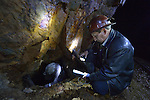 Freddy Llanos, a professor of mining engineering at Tomas Frias University, samples water quality inside the Kumurana Mine near Caiza D, Bolivia. The mine, which is closed, produces highly toxic acid runoff that negatively impacts the farms and lives of people living downstream. Llanos is working with an international coalition that is working with local miners and farmers to clean up the mine's runoff.