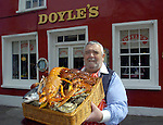 DOYLES SEAFOOD RESTAURANT OF THE YEAR IN DINGLE..<br /> Doyles Seafood Restaurant in Dingle was announced  the Bushmills-BIM Seafood Restaurant of the Year in Ireland 2005 and according to owner Sean Cluskey the achievement is an endorsement on the local industry as they only use local fresh fish direct from the fishermen. Our picture shows a jubiliant Sean Cluskey with a special locally produced fish basket after the announcement.<br /> Picture by Don MacMonagle