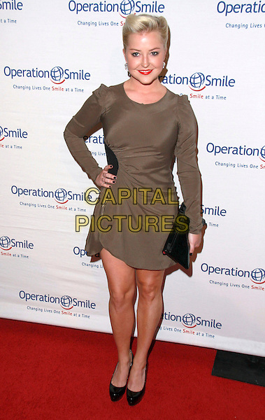 SAMANTHA MARQ.9th Annual Smile Gala Benefiting Operation Smile held at The Beverly Hilton Hotel, Beverly Hills, California, USA..September 24th, 2010.full length grey gray brown long sleeves dress black clutch bag hand on hip shoes .CAP/ADM/CH.©Charles Harris/AdMedia/Capital Pictures