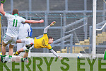 Darragh Tracey Limerick drives home Limerick goal past Kerry keeper Brian Kelly during the McGrath cup semi final in Killarney on Sunday
