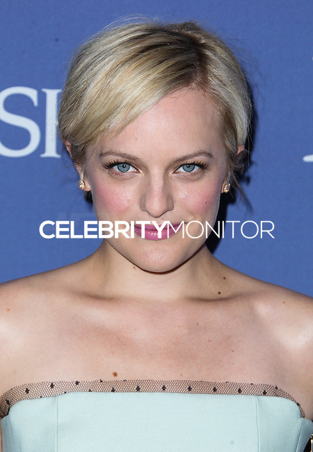 BEVERLY HILLS, CA- JUNE 12: Elisabeth Moss arrives at the Women In Film's 2013 Crystal + Lucy Awards at The Beverly Hilton Hotel on June 12, 2013 in Beverly Hills, California. (Photo by Celebrity Monitor)