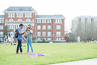 Students flying kites on Drill Field.<br />
