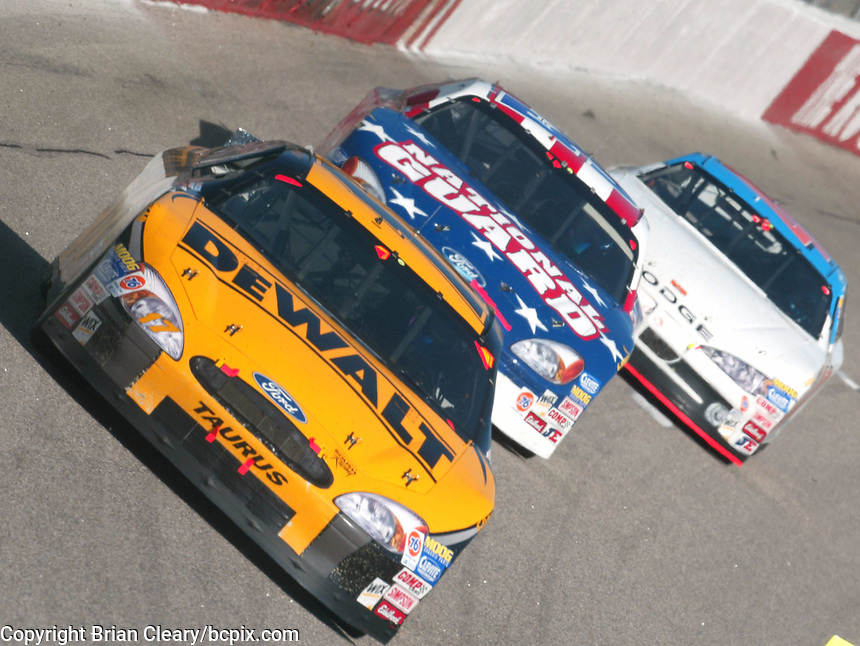 Matt Kenseth(17) leads a pack of cars on his way to clinching the 2003 Winston Cup Championship during  the Pop Secret 400 NASCAR Winston Cup race at Rockingham, NC on Sunday, November 9, 2003. (Photo by Brian Cleary)