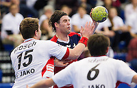 08 JAN 2012 - LONDON, GBR - Great Britain right back Steve Larsson (centre, in red) looks for a way past Austria's Fabian Posch (#15, in white) and Dominik Schmid (#6, in white) during the men's 2013 World Handball Championships qualification match against Austria at the National Sports Centre in Crystal Palace, Great Britain .(PHOTO (C) 2012 NIGEL FARROW)