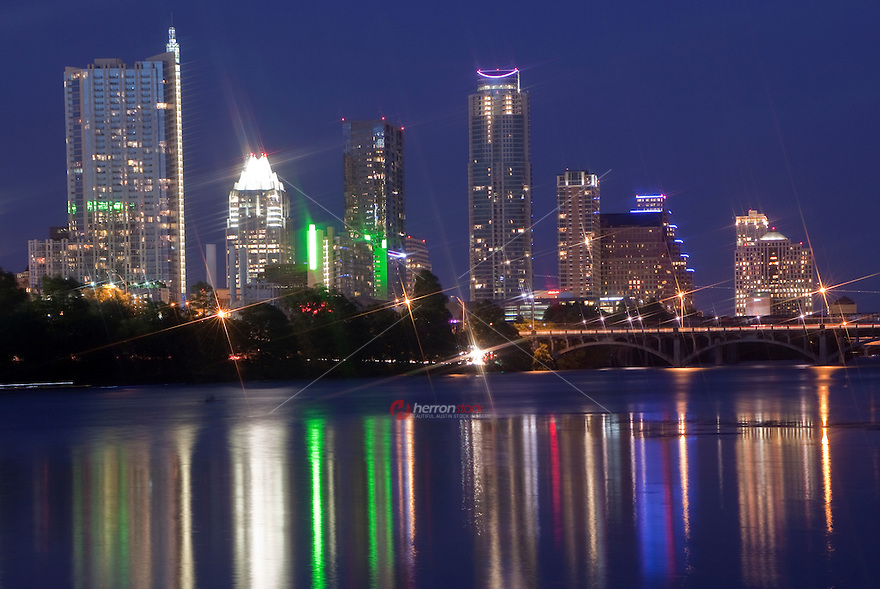 Austin Skyline with colorful nightime reflection on Lady Bird Lake.