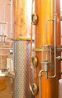 Distillation machine still with steel and copper boiler and column to make grape juice spirit. Detail. Kantina Miqesia or Medaur winery, Koplik. Albania, Balkan, Europe.