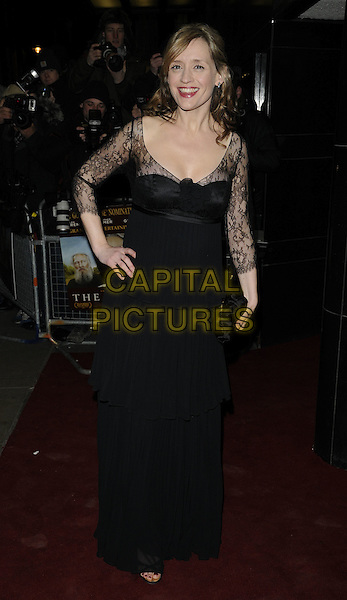 ANNE MARIE DUFF .The UK Premiere of 'The Last Station' at The Curzon Mayfair Cinema, London, England..January 26th 2010.full length black jacket dress lace clutch bag maxi hand on hip.CAP/CAN.©Can Nguyen/Capital Pictures.