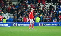 Aaron Ramsey of Wales looks dejected at full time of the FIFA World Cup Qualifying match between Wales and Serbia at the Cardiff City Stadium, Cardiff, Wales on 12 November 2016. Photo by Mark  Hawkins.