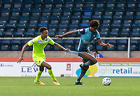 Sido Jombati of Wycombe Wanderers has his shorts pulled by Kurtis Guthrie of Colchester United during the Sky Bet League 2 match between Wycombe Wanderers and Colchester United at Adams Park, High Wycombe, England on 27 August 2016. Photo by Liam McAvoy.