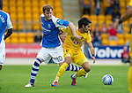 St Johnstone v Eskisehirspor...26.07.12  Europa League Qualifyer.Liam Craig battles with Alper Potuk.Picture by Graeme Hart..Copyright Perthshire Picture Agency.Tel: 01738 623350  Mobile: 07990 594431