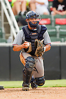 Rome Braves catcher Ryan Query #25 checks the runner at first base during the South Atlantic League game against the Kannapolis Intimidators at CMC-Northeast Stadium on August 5, 2012 in Kannapolis, North Carolina.  The Intimidators defeated the Braves 9-1.  (Brian Westerholt/Four Seam Images)