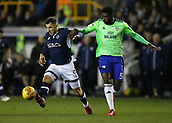 9th February 2018, The Den, London, England; EFL Championship football, Millwall versus Cardiff City; Bruno Ecuele Manga of Cardiff City puts pressure on Lee Gregory of Millwall