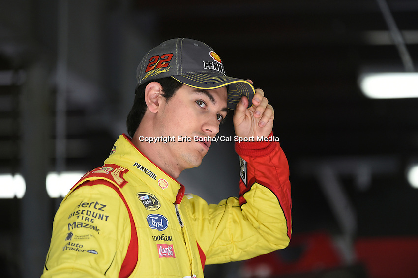 September 19, 2014 - Loudon, New Hampshire, U.S. -  Sprint Cup Series driver Joey Logano (22) waits in the garage for his car to be prepared for a practice session of the NASCAR Sprint Cup Series Sylvania 300 held at the New Hampshire Motor Speedway in Loudon, New Hampshire.   Eric Canha/CSM