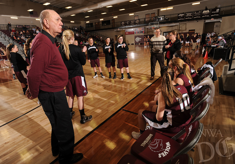 NWA Democrat-Gazette/ANDY SHUPE<br /> Longtime Huntsville girls basketball coach Charles Berry directs his team Friday, Jan. 8, 2016, from the bench during the Lady Eagles' win over Lincoln in Lincoln.
