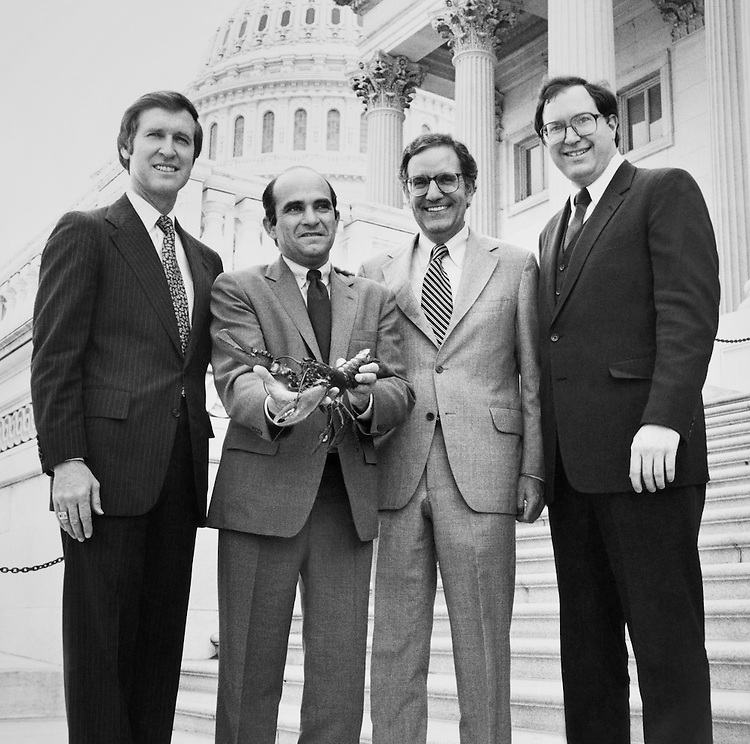 Sen. William Cohen, R-Maine, Sen. George John Mitchell, D-Maine, and Rep. David F. Emery, R-Maine, showing a lobster. May 12, 1982 (Photo by unknown/CQ Roll Call)