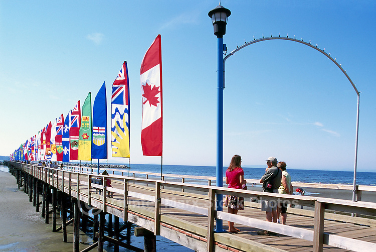White Rock, BC, British Columbia, Canada - Colourful Banners of Provincial Flags displayed on White Rock Pier along Semiahmoo Bay, Summer