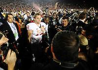Jan 7, 2010; Pasadena, CA, USA; Texas Longhorns quarterback Colt McCoy (12) walks off the field after the 2010 BCS national championship game against the Alabama Crimson Tide at the Rose Bowl.  Aalbama won 37-21. Mandatory Credit: Mark J. Rebilas-