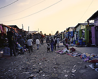 People walk through a market in Ethiopia's capital Addis Ababa on Tuesday November 10, 2009.
