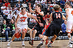SIOUX FALLS, SD - MARCH 19: Cole Benson #34 from Washington gets a step past Peyton Carr #42 from Huron in the first half of their quarterfinal game Thursday afternoon during the Boys State AA Basketball Tournament at the Denny Sanford Premire Center in Sioux Falls, SD. (Photo by Dave Eggen/Inertia)