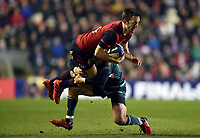 Darren Sweetnam of Munster Rugby is tackled by Matthew Tait of Leicester Tigers. European Rugby Champions Cup match, between Leicester Tigers and Munster Rugby on December 17, 2017 at Welford Road in Leicester, England. Photo by: Patrick Khachfe / JMP