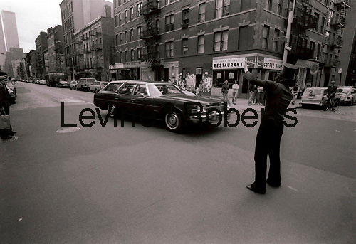 A performance artist at the intersection of West Broadway and Prince Street in Soho in the Spring of 1978. The view is looking Southwest with West Broadway on the left going downtown towards the WTC and Prince Street on the right going west. (© Richard B. Levine)