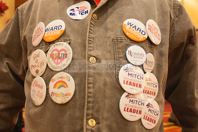 Mikey Smalls of Louisville displays Team Mitch campaign buttons at the Mitch McConnell victory celebration in Louisville, Ky.,on Tuesday, November 4, 2014. Photo by Michael Reaves | Staff