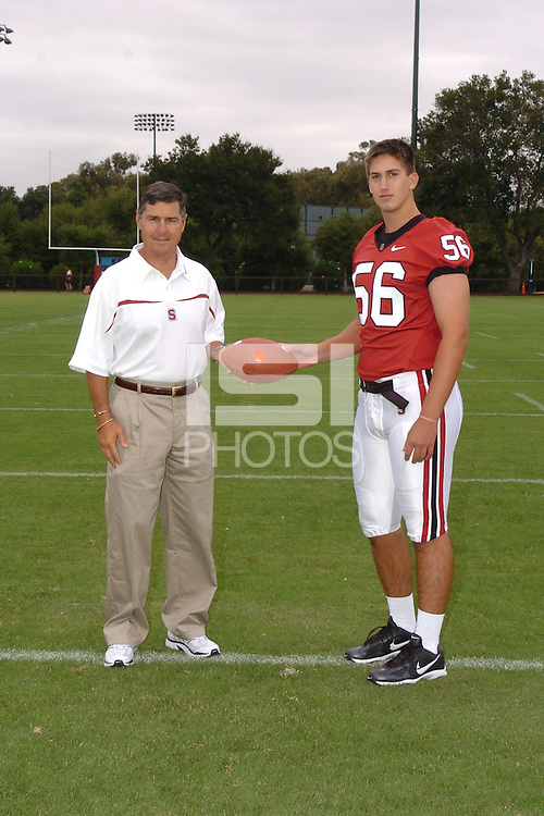 7 August 2006: Stanford Cardinal head coach Walt Harris and Zach Nolan during Stanford Football's Team Photo Day at Stanford Football's Practice Field in Stanford, CA.