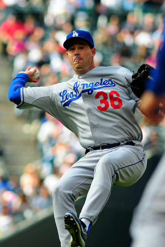 14 September 08: Los Angeles Dodgers pitcher Greg Maddux makes a throw to 1st base for an out against the Colorado Rockies. The Colorado Rockies defeated the Dodgers 1-0 in 10 innings at Coors Field in Denver, Colorado. FOR EDITORIAL USE ONLY
