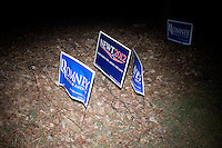 Mitt Romney campaign signs sandwich a Newt Gingrich sign outside the site of the GOP debate at St. Anselm College in Manchester, New Hampshire, on Jan. 7, 2012.