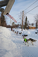 Allen Moore passes a basketball hoop on the road as he arrives into the Shageluk checkpoint  during Iditarod 2009