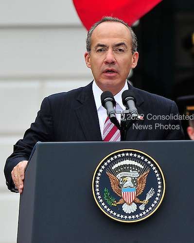 President Felipe Calderón of Mexico makes remarks as United States President Barack Obama welcomes him to the White House for a State Visit on Wednesday, May 19, 2010..Credit: Ron Sachs / CNP