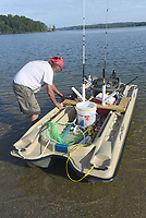 NWA Democrat-Gazette/FLIP PUTTHOFF <br /> LAKE DAY<br /> Mark Osborn of Rogers launches his fishing boat Tuesday Aug. 13 2019 at the Arkansas 12 bridge boat ramp at Beaver Lake. An electric motor powers the boat.