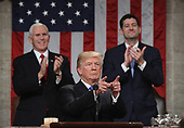 WASHINGTON, DC - JANUARY 30:  U.S. President Donald J. Trump waves during the State of the Union address as U.S. Vice President Mike Pence (L) and Speaker of the House U.S. Rep. Paul Ryan (R-WI) (R) look on in the chamber of the U.S. House of Representatives January 30, 2018 in Washington, DC. This is the first State of the Union address given by U.S. President Donald Trump and his second joint-session address to Congress. <br /> Credit: Win McNamee / Pool via CNP