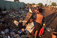 KHUTSONG, SOUTH AFRICA - OCTOBER 16: Children drop garbage on October 16, 2012, in Khutsong, South Africa. Khutsong, a black township. is located about 56 miles west of Johannesburg, and surrounded by gold mines. Because of recent strikes many mineworkers has been fired which is making the poverty worse here. The communal toilets are dirty and often broken.(Photo by Per-Anders Pettersson)