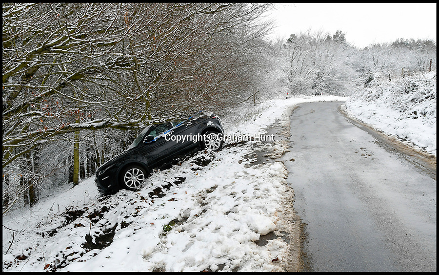 BNPS.co.uk (01202 558833)<br /> Pic: Graham Hunt/BNPS<br /> <br /> That looks expensive - A 4x4 Range Rover which slid off the road in the icy conditions stuck under some trees on Black Down in Dorset near Hardy's Monument.